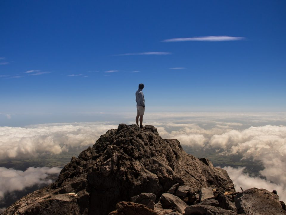 man standing on top of rock formation